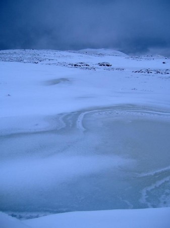 Frozen lochan on Ben Inverveigh