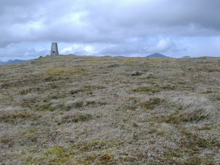 The grassy summit of Creag Uchdag